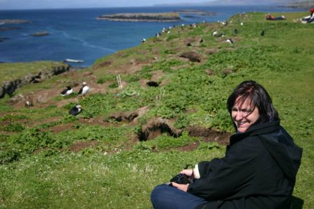 Sitting among the puffins of Lunga, Treshnish Isles, Scotland
